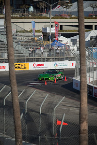 Since our grandstand is nearly empty at this hour, Pete and I walk to the end closest to Turn 11.  From the top, we can actually see over the fence at Turn 10.  The two palm trees make it impossible to use AI servo auto-focus, so I manually focus on the cones