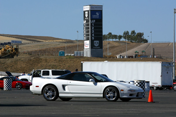 White NSX in front of the lap leaderboard