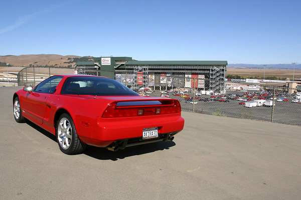 My car from the hillside overlooking the lot