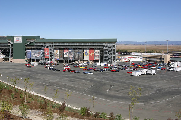 Hillside view of the lot (framed closer to the cars)