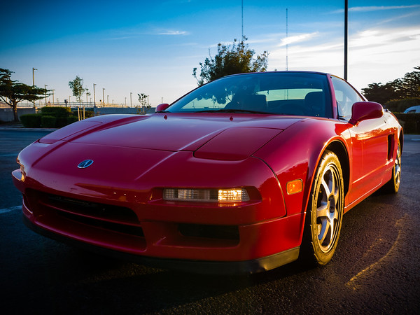 The sun is going down as my NSX waits in line for gas