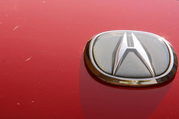As I dry the car, I notice some pretty gnarly scratches near the Acura emblem.  I have no idea how I got them