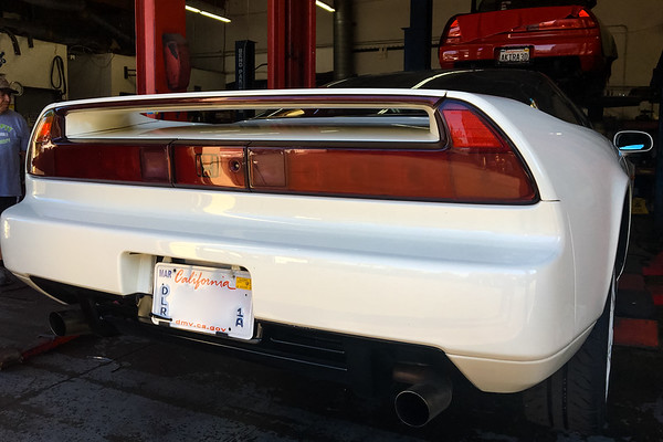 As I flip through Instagram, I spot my NSX in one of the posts...and there's now a white one sitting on the lift behind her (Photo by Brent Ilagan)