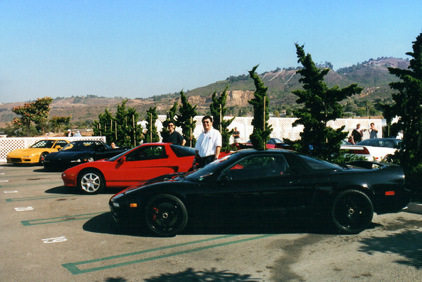 Dean and I stand proudly behind our cars.  From right to left, Dean and his black NSX, me with my red NSX-T, Justin hiding behind the driver's side door of his black NSX, and John's yellow NSX-T.