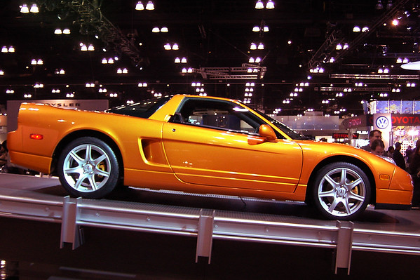 An Imola Orange 2002 NSX is on display, a color previously available, but only in Japan