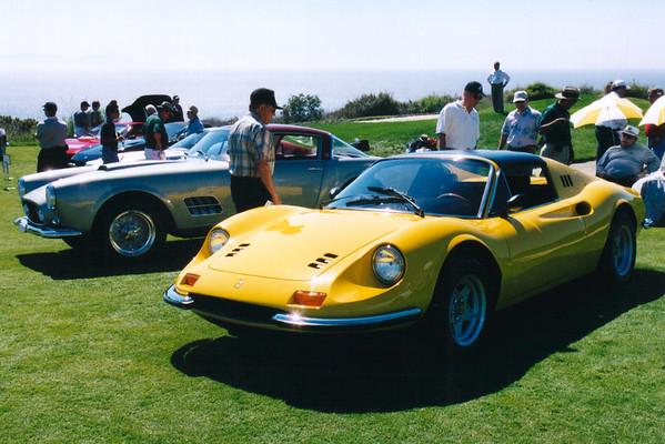 The 1957 Ferrari 410 Super America won the Best Sports Car award.  The yellow one is a 1974 Ferrari Dino 246GTS.