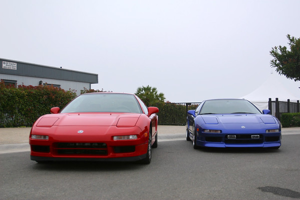 Red NSX parked next to blue