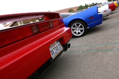 USC Alumni plate frame next to a NSX with a UCLA plate frame