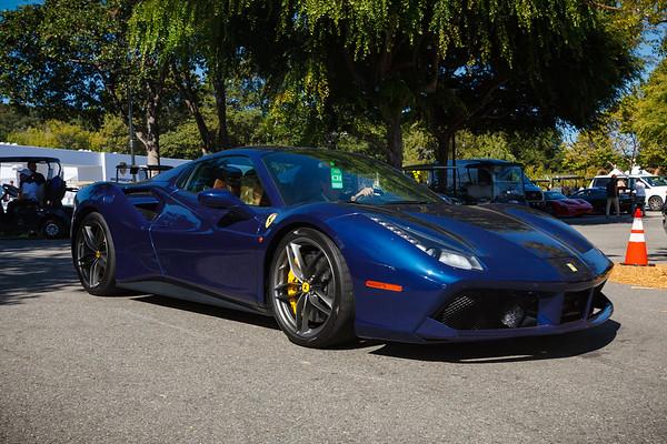 A Ferrari 488 enters parking lot CH
