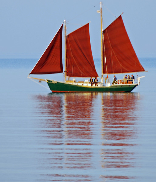 MP110.0 Schooner Hjordis: sailing outside the Grand Marais harbor on a rare still Lake Superior day.  The Hjordis belongs to the North House Folk School and takes groups out a couple of times a day during the summer.