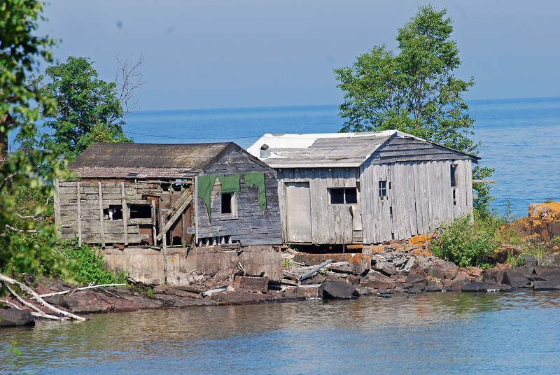 Some quant old commerical fishing houses on a small point between Grand Marais and Grand Portage.  The dock is long gone.  Only a handful of actual commerical fisherman remain on the lake, but you can taste their labor at several Grand Marais restaurants.