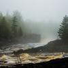 The raging St. Louis River on a foggy, misty day at Jay Cooke State Park.