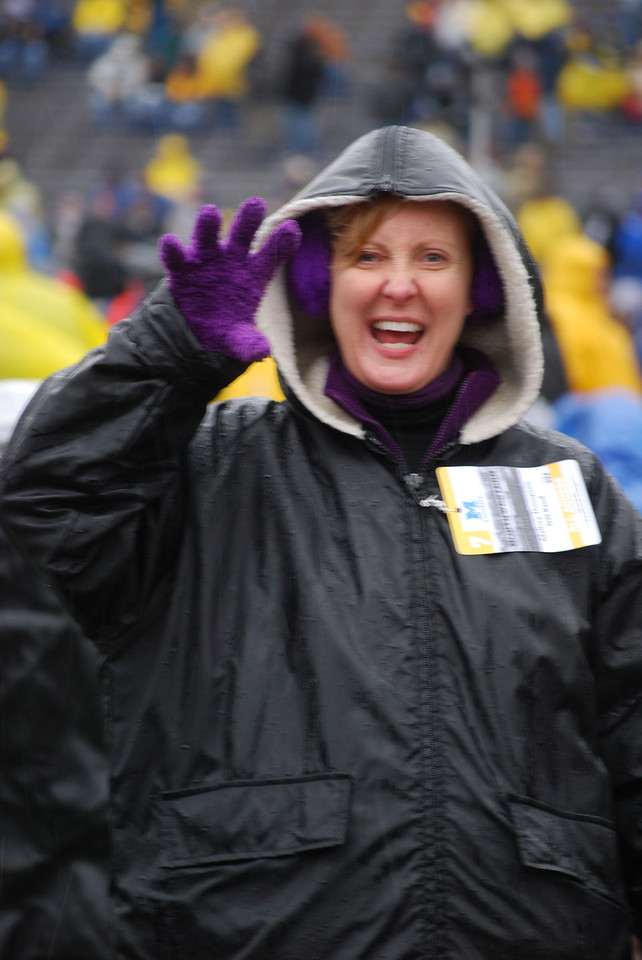 Dr. Thompson came prepared. Purple gloves, purple earmuffs. Still sodden.