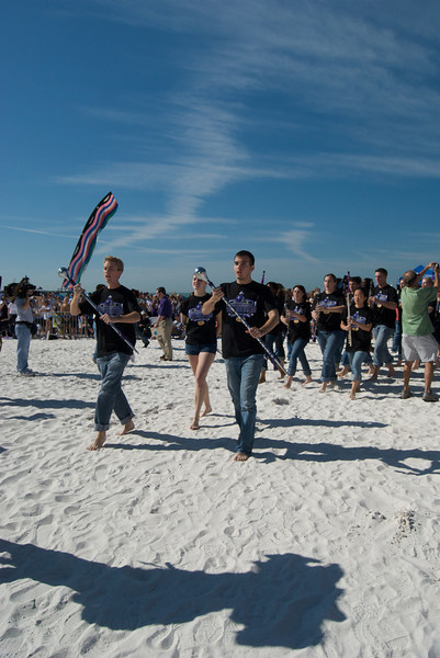Outback Bowl Beach Day Performance - NUMB marches barefoot on the beach.<br /> <br /> Photo by Tom McGrath