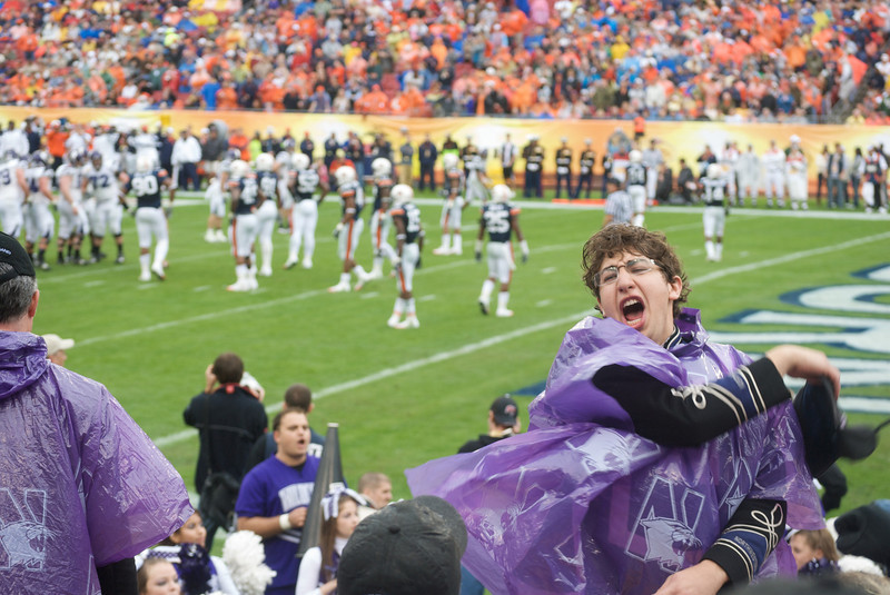 Spirit Leader Jed Feder cheers on the Wildcats. In the rain. In a poncho.<br /> <br /> Photo by Tom McGrath