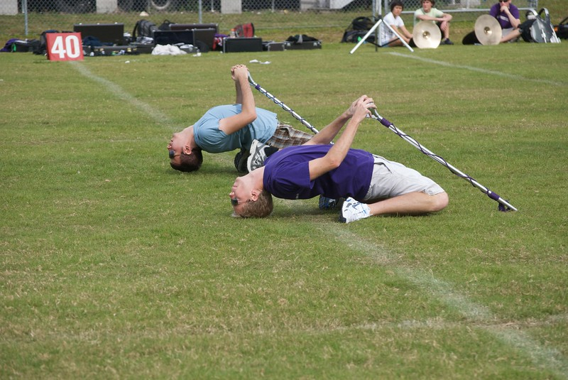 Drum Majors Will Borges and David Saad rehearse pregame. Shorts! Sunglasses! In December!<br /> <br /> Photo by Tom McGrath