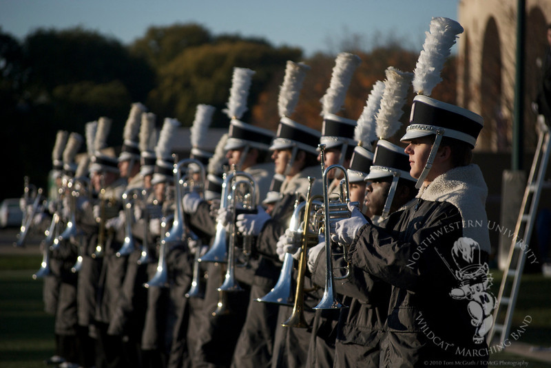 Brass players from the Northwestern University Marching Band stand at attention before rehearsing their halftime show.