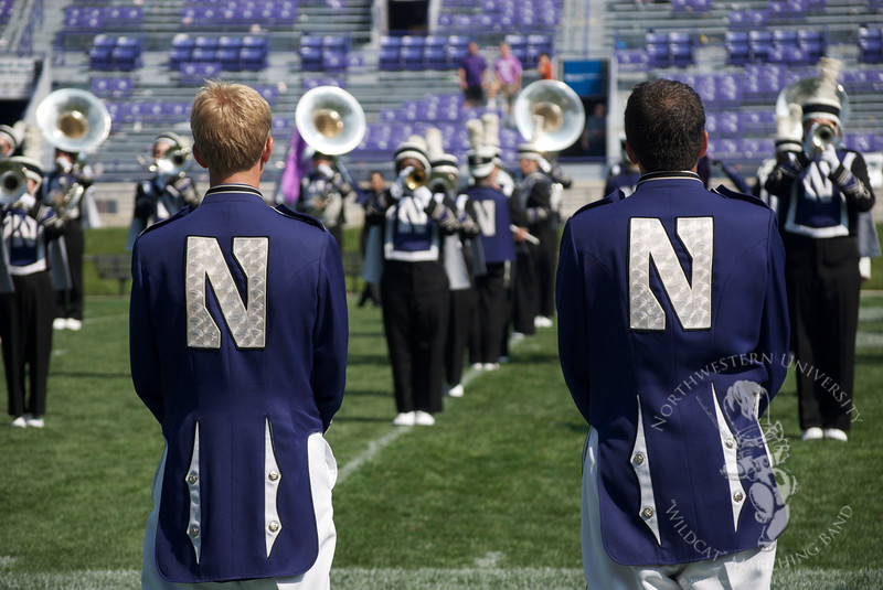 Drum majors David Saad and Will Borges observe the Northwestern University Marching Band's postgame show, 9/12/2009. NUMB has their shakos turned backwards to celebrate the victory over Eastern Michigan University.
