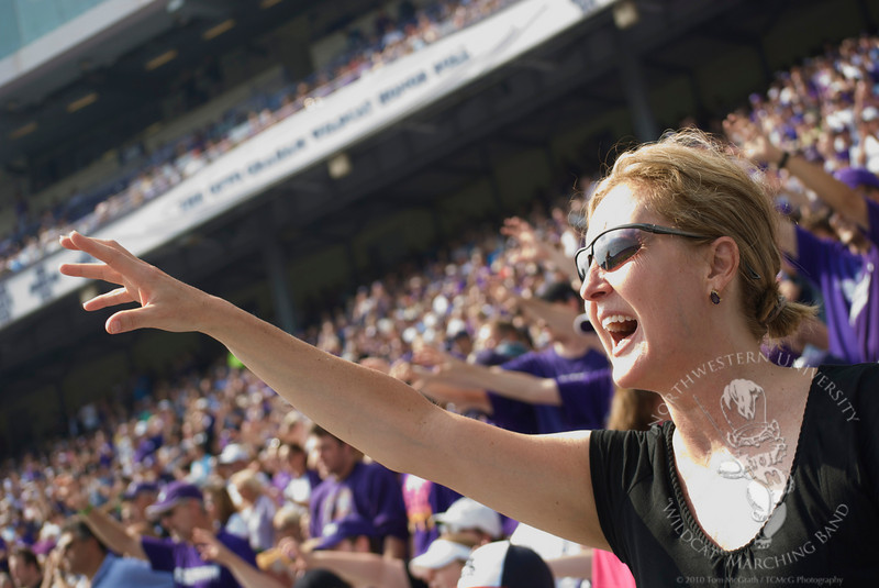 Dr. Mallory Thompson, Northwestern University's Director of Bands, growls during the game against Eastern Michigan University, 9/12/2009