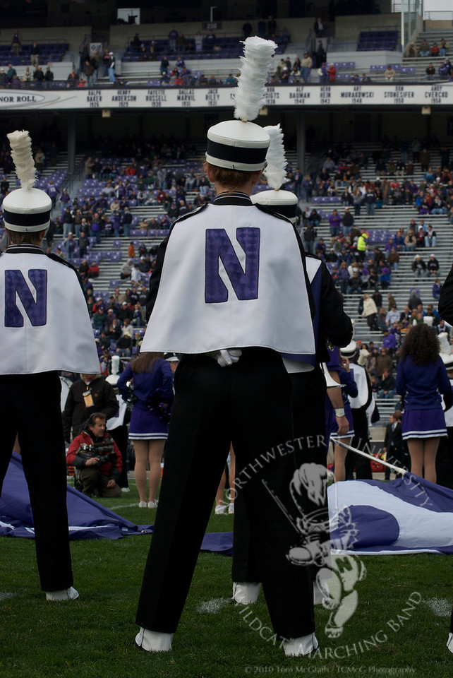"A member of the Northwestern University ""Wildcat"" Marching band at parade rest during pregame."
