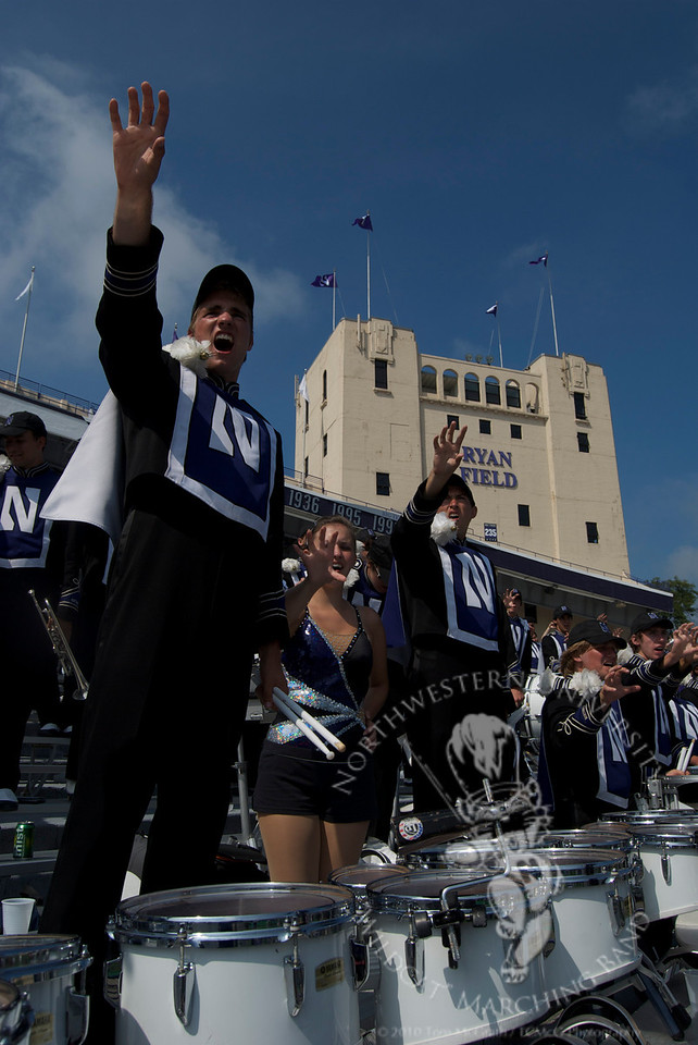 (l to r) Scott Olstad, Lauren Maginity, and Josh McComas growl during Northwestern vs. Eastern Michigan, 9/12/2009