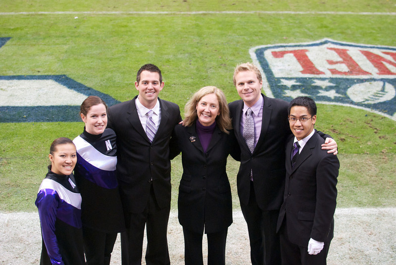 Dr. Thompson and graduate conducting students before the Northwestern/Texas A&M Meineke Car Care Bowl of Texas, December 31, 2011