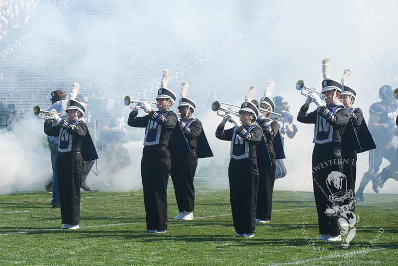 Northwestern vs. Central Michigan  at Ryan Field, September 25, 2010<br /> <br /> Members of Northwestern's football team run through a cloud of smoke and the traditional tunnel formed by the band at the end of the pregame show.