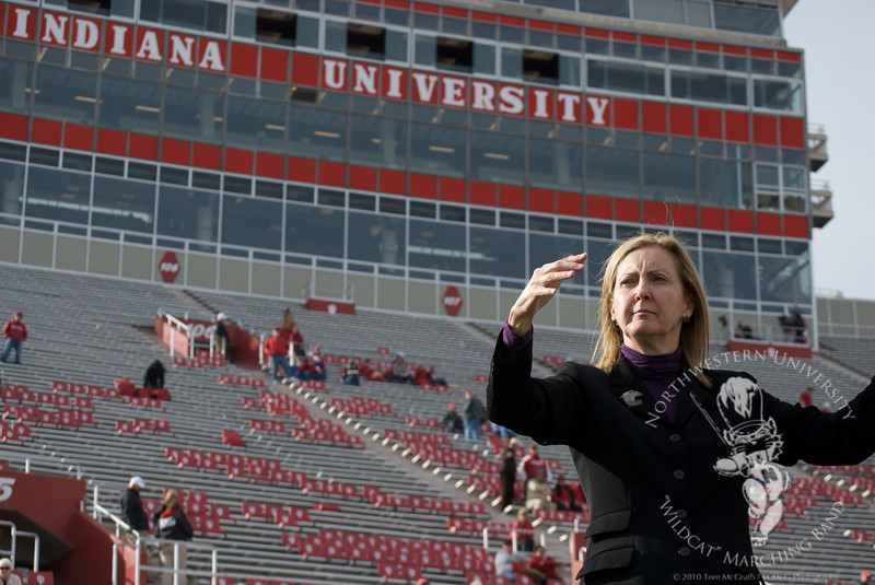 Dr. Mallory Thompson conducts the Northwestern Alma Mater in Indiana's Memorial Stadium after Northwestern's victory over Indiana, October 30, 2010