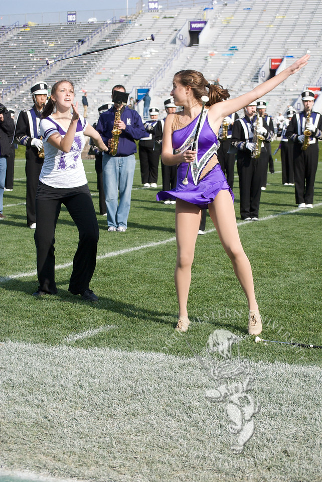 Former and current featured twirlers Lauren (left) and Kali Maginity (right) perform during postgame of the Northwestern 2010 Homecoming game.