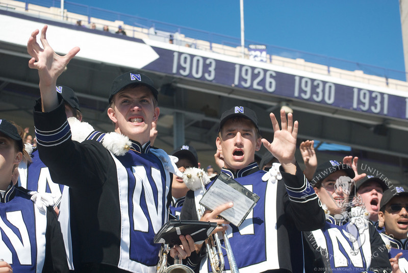 Northwestern vs. Central Michigan  at Ryan Field, September 25, 2010<br /> <br /> Alex Hurd (l) and the trumpet section encourage the Northwestern defense during the first quarter of Northwestern's 30-25 victory over Central Michigan.