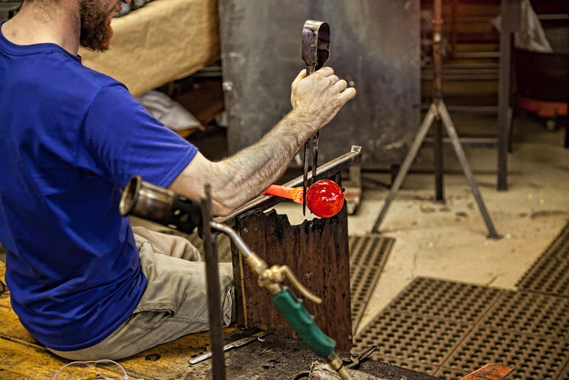 Glass Blower Applying his Artistic Touch