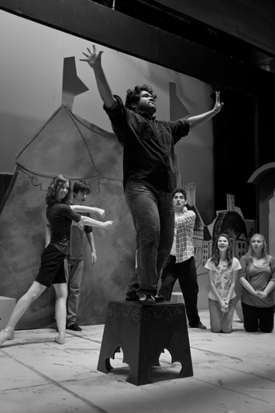 """#813: """"The Gypsies perform circus acts for the Girls.""""; <br /> Front: Paul Susi (Strong Man)<br /> Back, left to right: Kylie DeHaven (Petronella), Sean Sele (Gypsy), John Ellingson (Clown), Claire Aldridge (Girl), Alyssa Haning (Girl)"""