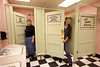"""Cindi Kinder and Patty Hanson check out the new floor and painting done for the """"Little Girls Room"""", complete with a spider in the """"Little Miss Muffet"""" stall."""