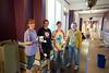 Volunteers painting the back hallways