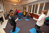 """Sarah Jane Hardy (with Bryan Kinder assisting)  teaches a dance class on """"pretend dance floor"""" squares during the recent  Open House event.  Donations are being collected to make this room into a new dance studio."""