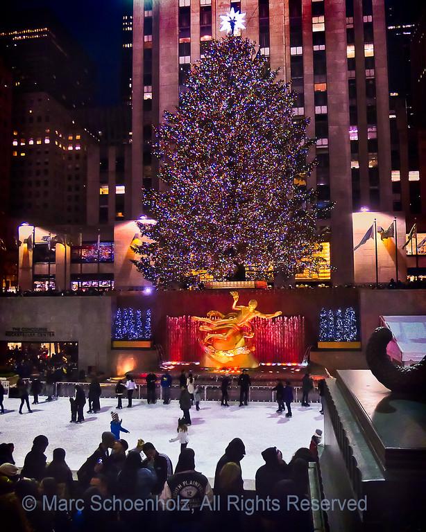 Rockefeller Center ;  Photographed at:  Christmas on Fifth Avenue,  New York, NY,  December,  2011    © 2011 Marc Schoenholz  Camera:  Panasonic DMC-LX5 Lens:  6 Shutter Speed:  1/80;  Aperture:  2 ISO Setting:  800