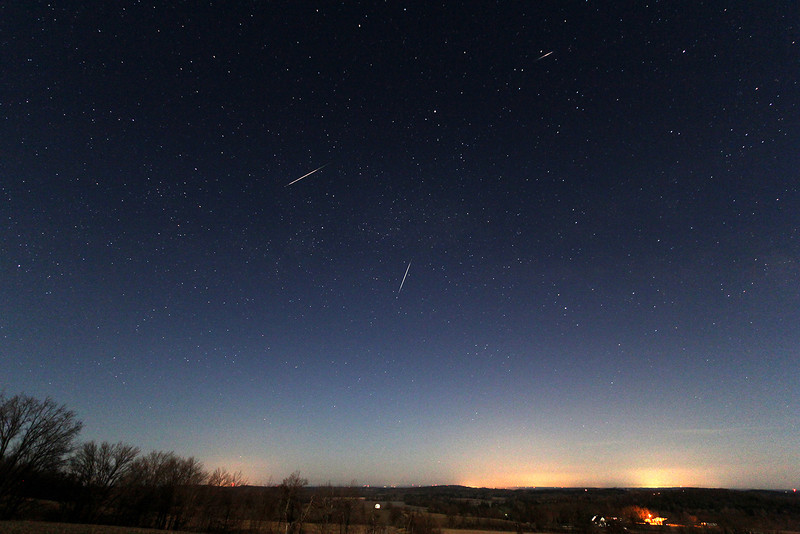 """Three bright Lyrids as seen from Sandy Flats Road near Roseneath ON.  This is a composite of three images taken (meteors from left to right) April 22, 2013 at 2:28 am, 3:05 am and 1:55 am respectively.  All images were taken with a Canon 60D camera using a Canon 10-22 f/3.5 lens set at 10mm f/3.5, ISO 800 and 15"""" exposure.  Photo by Andreas Gada, Oak Heights Astronomical."""