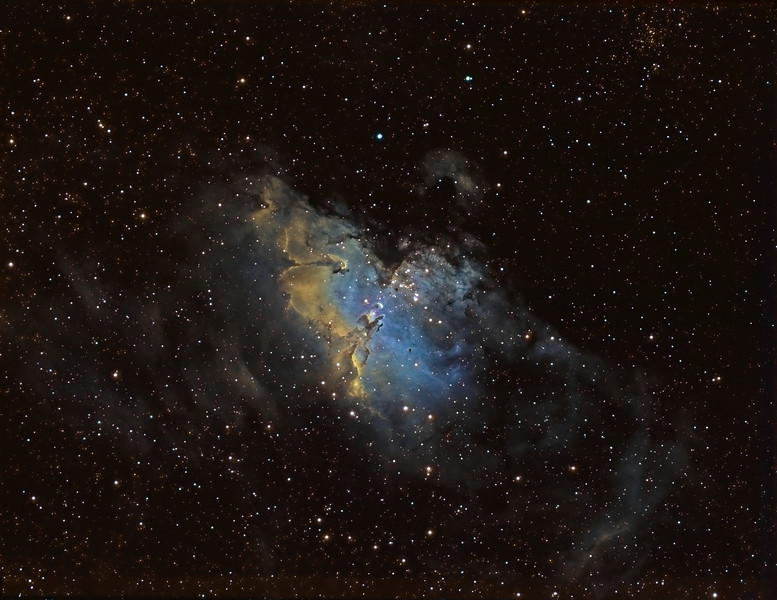 The Eagle Nebula M16 wide field in Hubble palette showing SII Ha OIII. Taken with NP101is at f 8.1 with tele extender giving 800mm.<br /> 15x20m Ha, !0x 20m SII, 10x20m OIII. Taken by Lynn Hilborn, Grafton,Ontario July 6,7,10,11, 2010