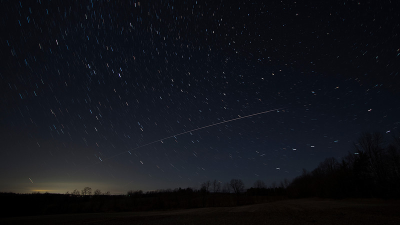 """Andreas Gada,  !SS fly over on December 19, 2012 at 18:25 EST as seen from Sandy Flats.  Composite of nine 30"""" images taken with a Canon 60Da, Canon 10 - 22 mm lens set at 10 mm and f /3.5, ISO 800."""