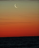 27 Day moon and Mars (look closely below and to right of Moon) about 6:30 am over Lake Ontario.<br /> Lynn Hilborn