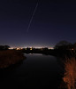 ISS would be passing overhead at 5:50, so I headed out at 5:30pm EDT to take some pics. I combined 4 images to show the transit facing east north east. Note the reflection of ISS in the water below. A nice Remembrance Day sight on 11_11_2009.<br /> Malcolm Park