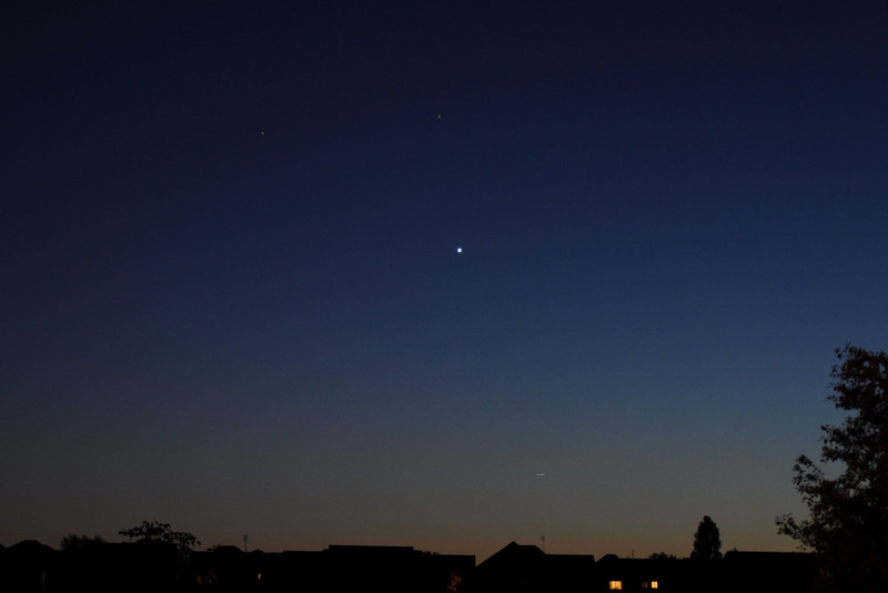 Grouping of Venus, Saturn and Mars taken from Whitby, Ont. looking West on August 6, 2010 around 9:30pm.  Venus is the bright one and Saturn is top right.   Streak above roof tops is an aircraft.  Taken with Nikon D90 and Nikkor 18-105 ED zoom lens mounted on tripod. Dave Ledger
