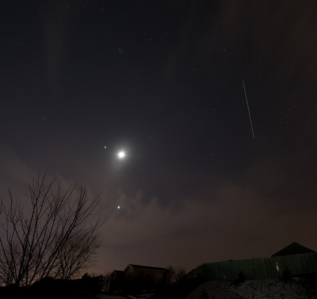 International Space Station cruises by the planetary conjunction of Jupiter, Moon and Venus in a lucky opening in the cloud cover.<br /> Nikon D3s 25 sec exp, 14mm 1600 iso f8