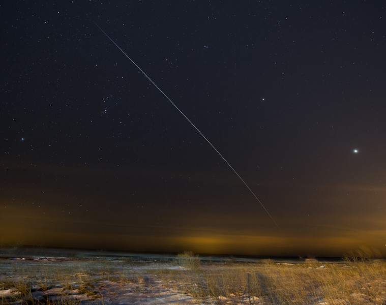 ISS pass over Lake Ontario with Venus and Jupiter to the right, and Orion and Sirius to the left<br /> Nikon D3s<br /> 30 seconds exposure x 9<br /> iso 2500 <br /> f.8<br /> Astrotrac used to prevent stars from trailing.<br /> Stacked in Startrails and edited in CS5 and Lightroom.