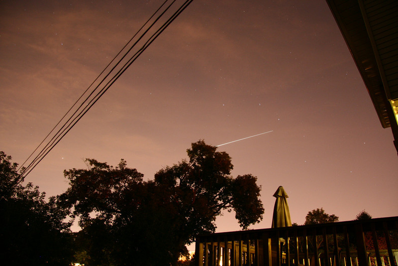 Shuttle STS128 on Sept. 9, 2009, from my Beaches back deck.  The orange glow is from Toronto's light pollution.