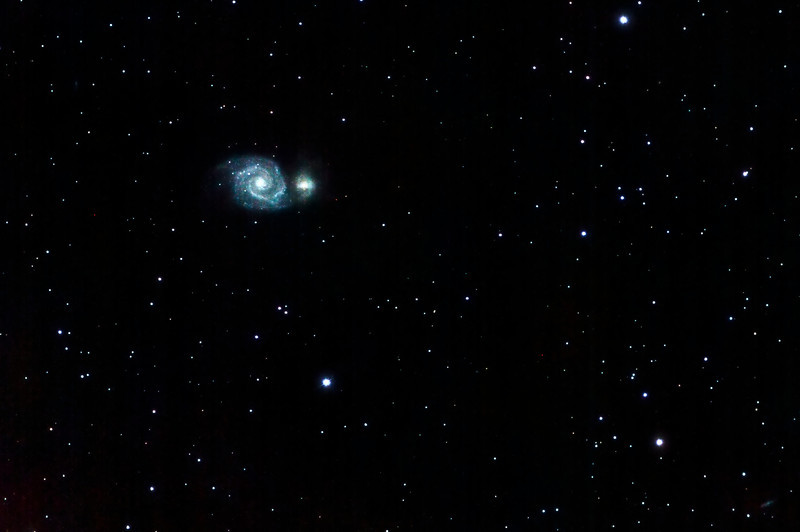 M51 - The Whirlpool Galaxy.  After Cathy showed me this beauty in her Dob, I had to try imaging it!<br /> <br /> Canon T1i, Stellarvue SV102ED2 scope, mounted on Vixen NexSXW.  11 x 5 min subs, preprocessed in Nebulosity 3, post-processed in Pixinsight, cropped and a small vibrance touchup in Lightroom.