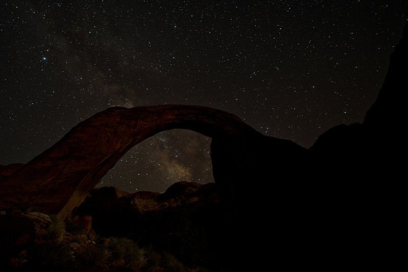 2 images combined in CS5, each with identical settings, but one taken in the early evening, the other in the early morning on a tripod. <br /> Nikon D3s @f/2.8, 14mm, ISO 1600, 2 x 25 sec. exposures.<br /> Rainbow Bridge, Utah (near Page)<br /> Malcolm Park