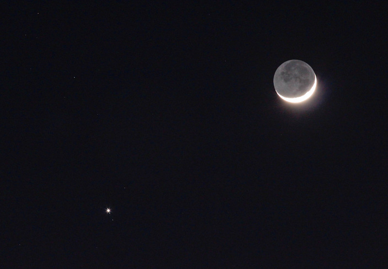 New version on previous Moon and Jupiter image. Cropped and adjusted in Lightroom.<br /> John Merchant