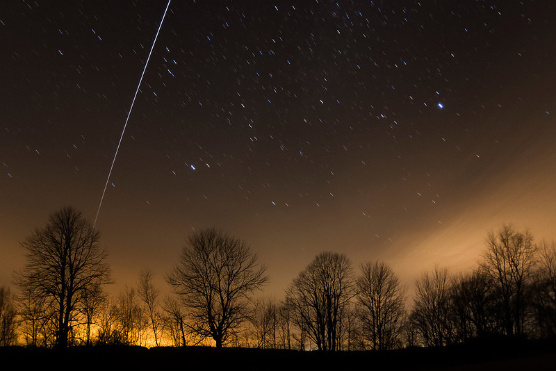 "Andreas Gada,  !SS fly over on December 13, 2012 at 18:34 EST as seen from Sandy Flats.  Composite of three 30"" images taken with a Canon 40D, Nikkor 16mm lens set at 10 mm and f /3.5, ISO 1600."