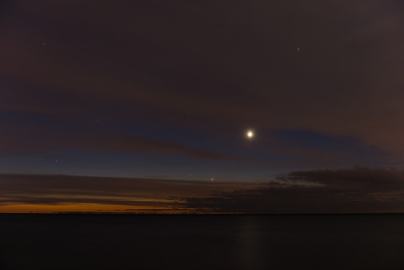 The clouds parted for a clear view of Mercury this morning (dec 6 2012) at 6:00am EST over the waters of Lake Ontario. Cloud slightly obscured Saturn and Venus but all three are clearly visible. It was a chilly -6c but well worth it. My best visual observation of Mercury ever. It was easy to see shining brightly once it cleared the clouds.